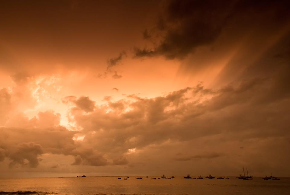 Golden hour sunset during rainy season in Costa Rica. hotographed by Samba to the Sea.