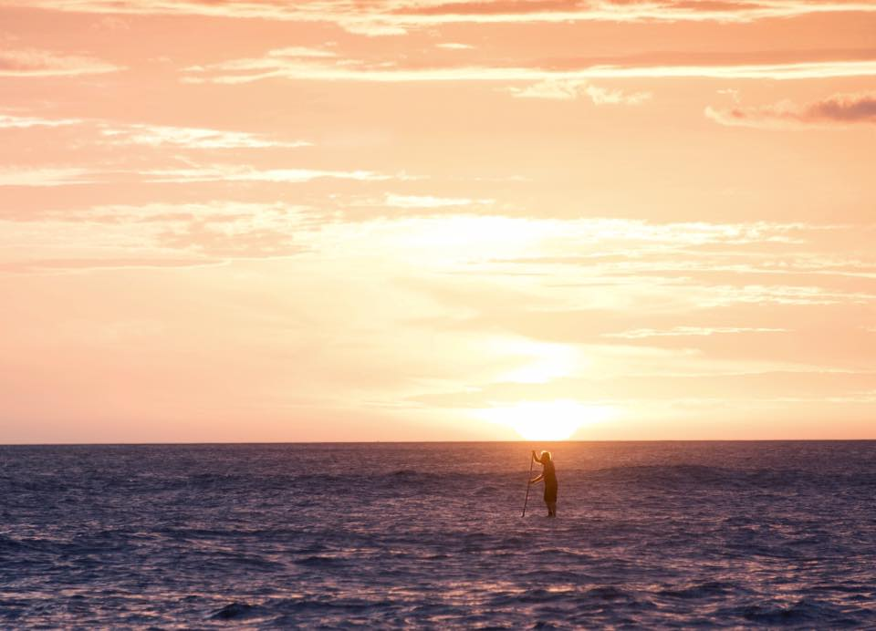 Stand up paddling during sunset in Costa Rica. hotographed by Samba to the Sea.