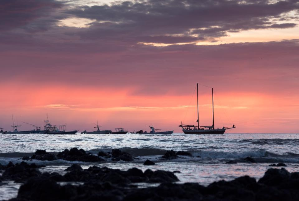 Pink sunset in Tamarindo, Costa Rica. Photographed by Samba to the Sea.