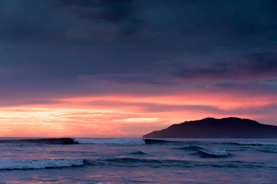 Breaking A-Frame wave during sunset in Tamarindo, Costa Rica. hotographed by Samba to the Sea.