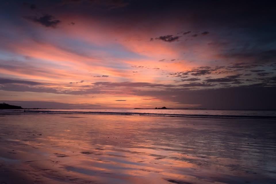Beautiful pink sunset in Tamarindo, Costa Rica. Photographed by Kristen M. Brown, Samba to the Sea.