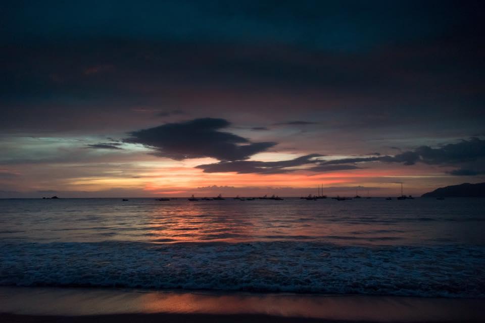 Beautiful sunset in Tamarindo, Costa Rica. Photographed by Samba to the Sea.