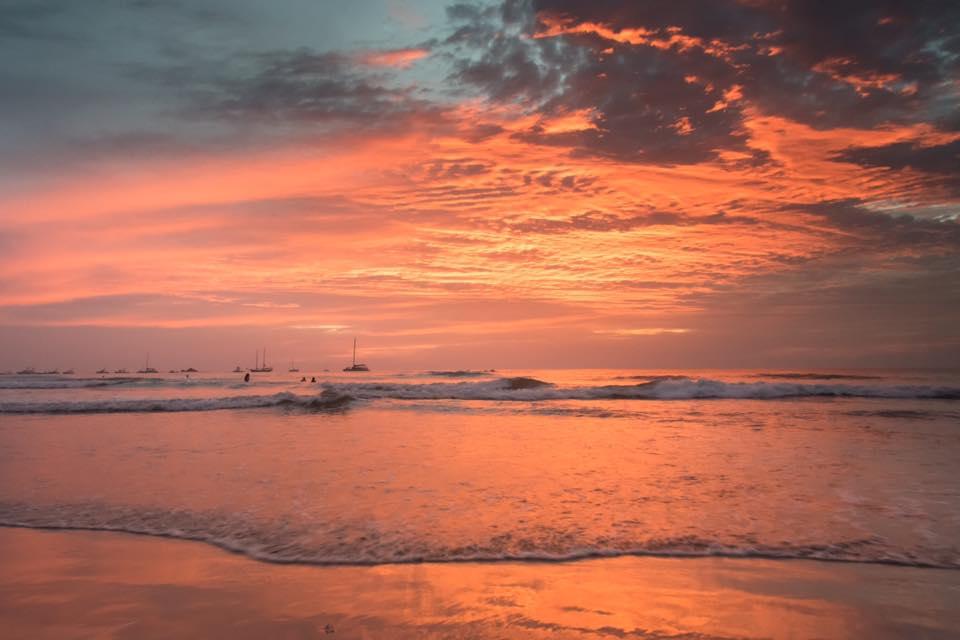 Fire orange sunset in Tamarindo, Costa Rica. Photographed by Samba to the Sea.