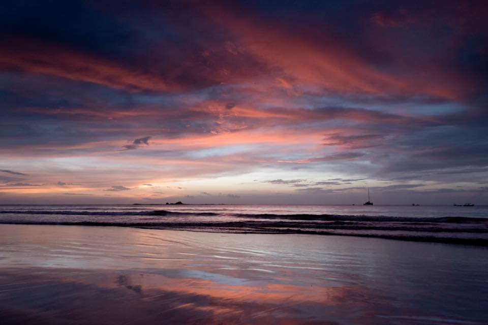 Magenta pink sunset in Tamarindo, Costa Rica. Photographed by Samba to the Sea.