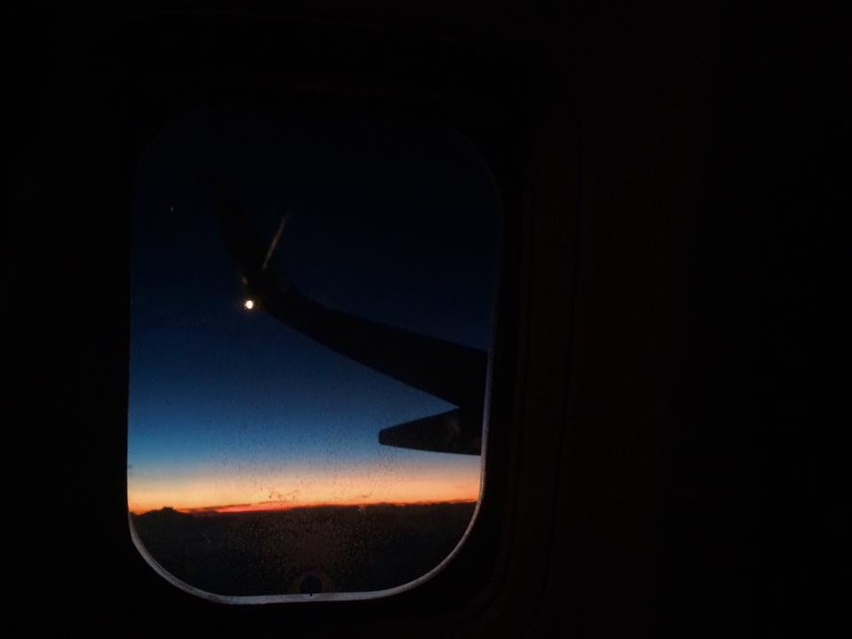 Sunset from the air on Delta Airlines. Photographed by Kristen M. Brown, Samba to the Sea.
