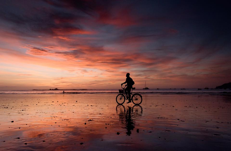 Commuting home with a beach cruise on the beach during a stunning Costa Rican sunset. Photographed by Kristen M. Brown, Samba to the Sea Photography.