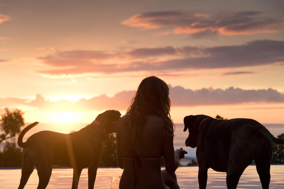 Woman and her dogs enjoying a beautiful sunset in Costa Rica. Photographed by Kristen M. Brown, Samba to the Sea.