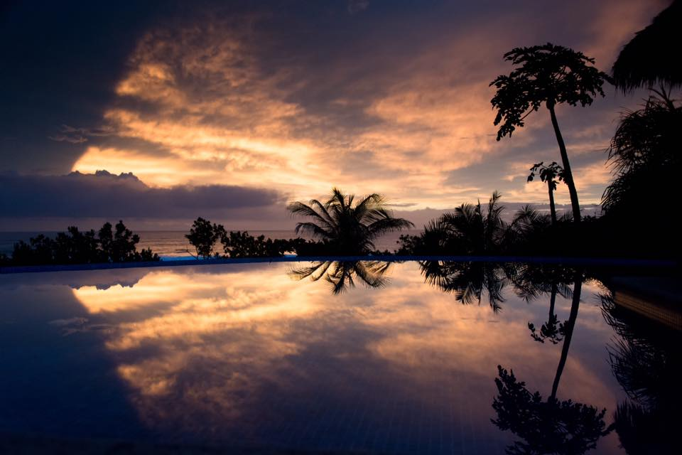 Sunset reflections in an infinity pool in Costa Rica. Photographed by Kristen M. Brown, Samba to the Sea.