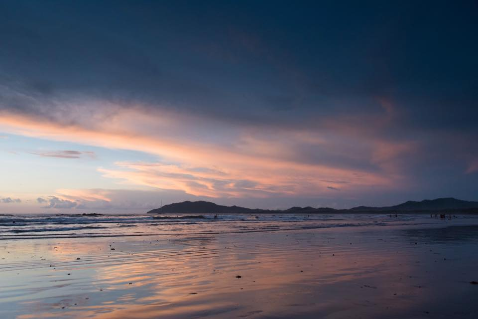 Pastel sunset in Tamarindo, Costa Rica. Photographed by Samba to the Sea Photography.