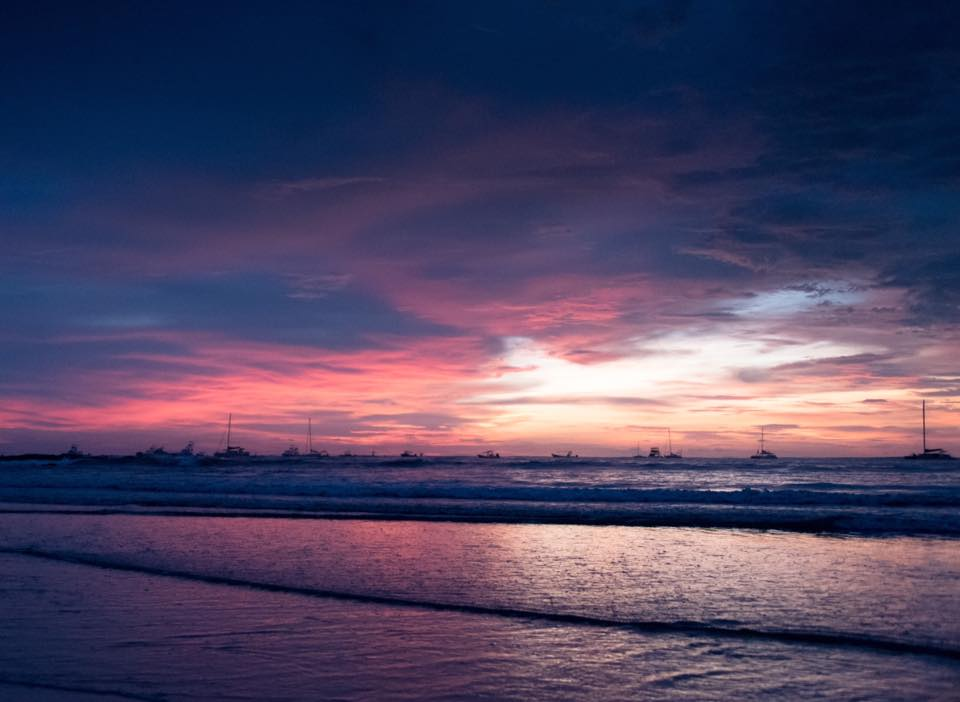 Purple sunset in Tamarindo, Costa Rica. Photographed by Samba to the Sea Photography.
