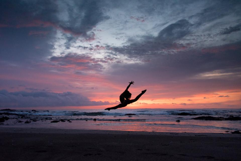 Dancer jumping in the air during a gorgeous sunset in Junquillal, Costa Rica. Photographed by Kristen M. Brown, Samba to the Sea Photography.