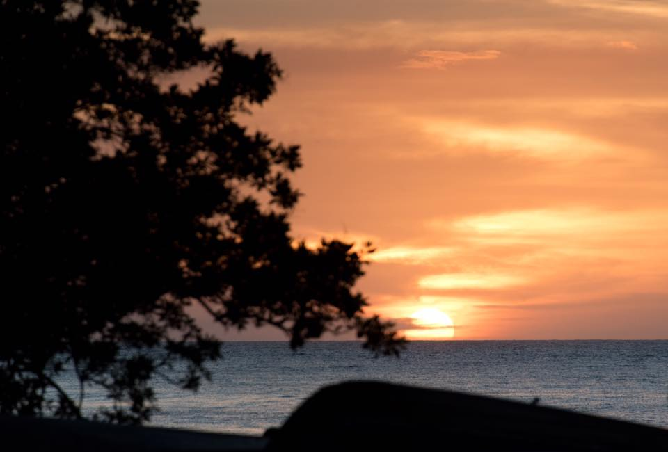 Orange sunset in Tamarindo, Costa Rica. Photographed by Samba to the Sea Photography.