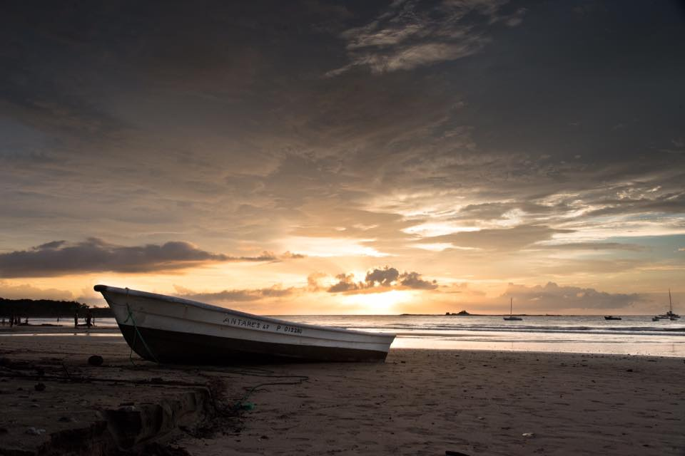Panga boat on the beach during a beautiful sunset in Tamarindo, Costa Rica. Photographed by Kristen M. Brown, Samba to the Sea.