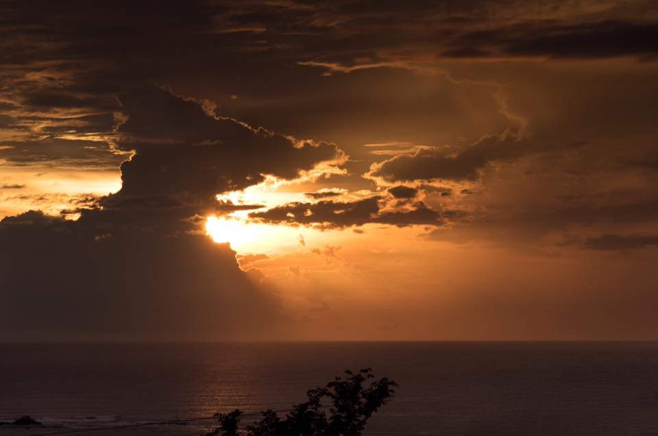 Rainy season sunset in Costa Rica. Photographed by Kristen M. Brown, Samba to the Sea Photography.