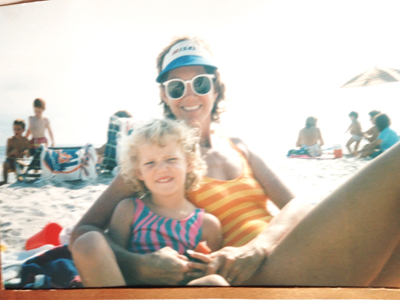 Old photograph of mother and daughter at beach.