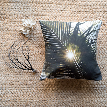 Palm leaf sun star accent pillow by Samba to the Sea.