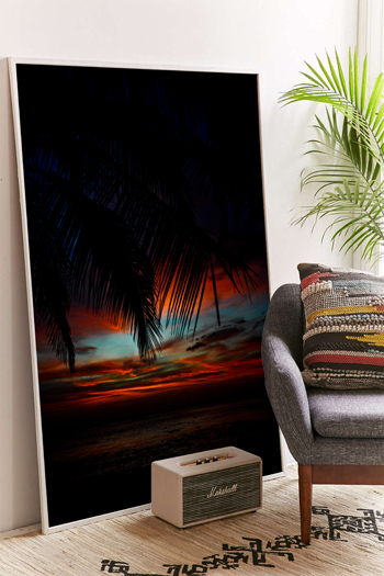 Palm tree leaves silhouetted by a red sunset sky in Tamarindo, Costa Rica. Fine art print by Kristen M. Brown, Samba to the Sea.