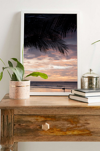 Palm tree and surfer silhouette during a gorgeous sunset in Tamarindo, Costa Rica. Fine art print by Kristen M. Brown, Samba to the Sea.