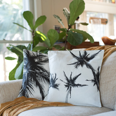 Black and white palm trees accent pillow by Samba to the Sea.