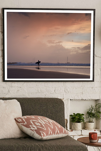 Surfer walking on the beach during a pastel pink sunset in Tamarindo, Costa Rica. Fine art print by Kristen M. Brown, Samba to the Sea.