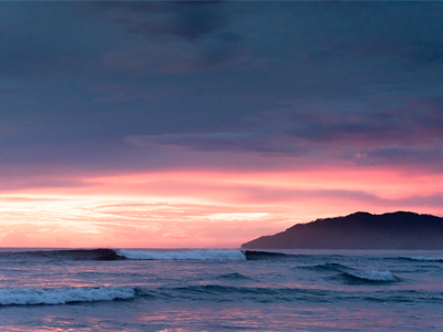 Breaking a-frame wave during sunset in Tamarindo, Costa Rica. Photographed by Kristen M. Brown, Samba to the Sea Photography.