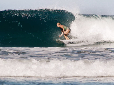 Kristen Brown surfing at Playa Avellanas in Costa Rica.